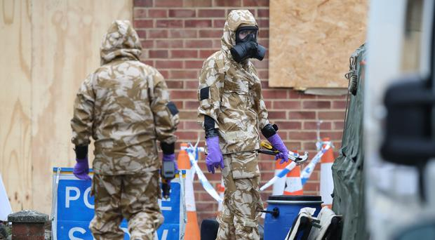 Members of the military wear protective clothing as work continues on the home of former Russian spy Sergei Skripal in Salisbury (Andrew Matthews/PA)