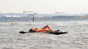 A woman basks in the sun on her paddleboard on Belfast Lough yesterday
