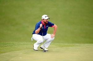 Ireland's Shane Lowry lines up a shot during Round 1 of the 80th Masters Golf Tournament at the Augusta National Golf Club on April 7, 2016, in Augusta, Georgia.  / AFP PHOTO / Jim WatsonJIM WATSON/AFP/Getty Images