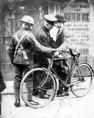 RIOTS: BELFAST 1922. Cyclist being searched. (No trace in newspaper)..18/02/22. 1922-138.