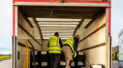 Election boxes are loaded into a lorry to deliver around Northern Ireland