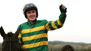 Champion Co Antrim jockey Tony McCoy has made history by securing 4,000 career wins. Pictured on Thursday on winner Mountain Tunes
