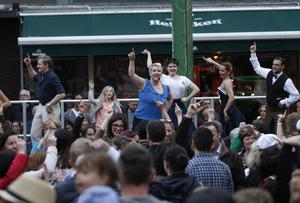 Entertainers take to the stage in the Cathedral quarter in Belfast during culture night.  Picture by Peter Morrison