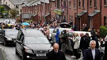 Mourners lined the streets as John Hume's coffin leaves St Eugene's Cathedral. Pic Alan Lewis - Photopress