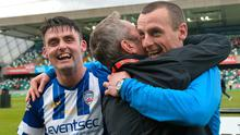Dream team: Eoin Bradley looks on as Oran Kearney is hugged by James Nesbitt after guiding Coleraine to Irish Cup success in 2018