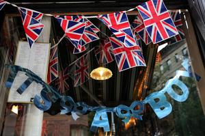 "NEW YORK, NY - JULY 22:  A sign in the window of the British restaurant and grocery Tea & Sympathy reads. ""It's A Boy"" as it celebrates the birth of Catherine, Duchess of Cambridge, and her husband Prince William's first child on July 22, 2013 in New York City. The Royal couple had a baby boy who was born at 16.24 BST and weighed 8 pounds, 6 ounces. The child, who is now third in line to the throne, has yet to be named.  (Photo by Spencer Platt/Getty Images)"