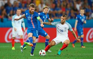 NICE, FRANCE - JUNE 27: Aron Gunnarsson of Iceland and Jack Wilshire of England compete for the ball during the UEFA EURO 2016 round of 16 match between England and Iceland at Allianz Riviera Stadium on June 27, 2016 in Nice, France.  (Photo by Lars Baron/Getty Images)