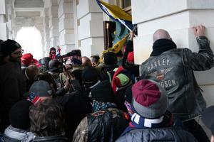 Demonstrators try to open a door of the U.S. Capitol on Wednesday, Jan. 6, 2021, in Washington. (AP Photo/Jose Luis Magana)