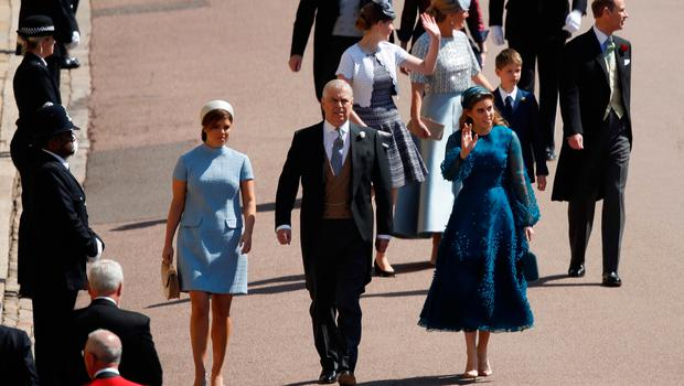 Britain's Prince Andrew, Duke of York, (C) arrives with Britain's Princess Beatrice of York (R) and Britain's Princess Eugenie of York (L) arrive for the wedding ceremony of Britain's Prince Harry, Duke of Sussex and US actress Meghan Markle at St George's Chapel, Windsor Castle, in Windsor, on May 19, 2018. / AFP PHOTO / POOL AND AFP PHOTO / Odd ANDERSENODD ANDERSEN/AFP/Getty Images