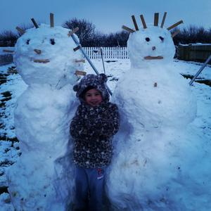 Proudly showing off their snowmen as children enjoy the snowfall in Northern Ireland. Pic. Michelle Wilmont 14/01/2015