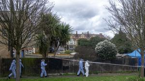 Police forensics officers work at the property on Darell Road in Kew (Steve Parsons/PA)