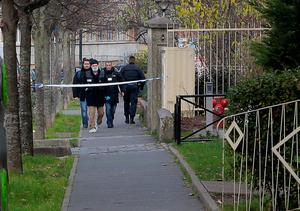 """Judicial police are seen outside Jean-Perrin nursery school in Aubervilliers, a suburb northeast of Paris, where a teacher was attacked in the morning by a man wielding a box cutter and scissors who cited the Islamic State (IS) jihadist group, sources in the police and prosecutor's office said. The 45-year-old teacher was stabbed in the side and throat while preparing for his class at the school, but his life was not in danger, a police source said. The assault comes after the Islamic State in November urged its followers to kill teachers in the French education system for teaching secularism and being """"in open war against the Muslim family"""". / AFP / JACQUES DEMARTHONJACQUES DEMARTHON/AFP/Getty Images"""
