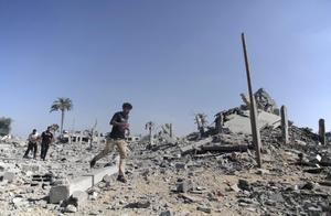 Palestinians rush to inspect the damage of their houses caused by Israeli strikes in the village of Khuzaa, southern Gaza Strip, close to the Israeli border, Friday, Aug. 1, 2014.  (AP Photo/Khalil Hamra)