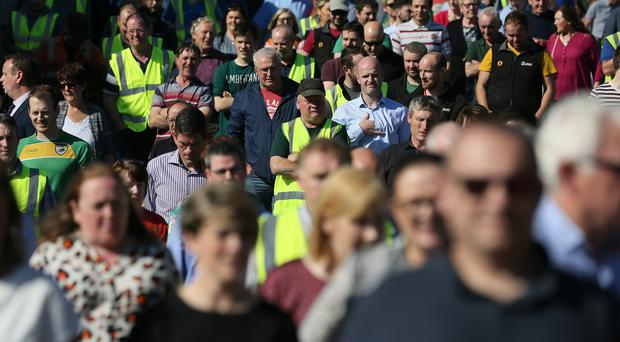 Workers from Quinn Industrial Holdings gather for an event to show solidarity with Kevin Lunney (Brian Lawless/PA)