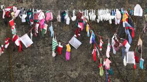 Childrens socks at the grotto on an unmarked mass grave at the site of the Tuam Mother and Baby Home run by the Bon Secours sister (Niall Carson/PA)