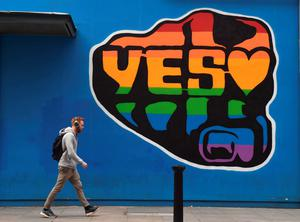 A man walks past a mural promoting the Yes campaign in favour of same-sex marriage on May 22, 2015 in Dublin, Ireland.  (Photo by Charles McQuillan/Getty Images)