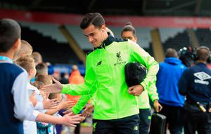 Liverpool's Philippe Coutinho arrives for the Premier League match at the Liberty Stadium, Swansea. PA
