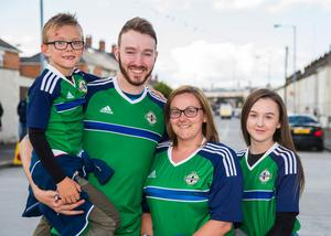 Northern Ireland fan Matthew Cromie (7) with his dad Gareth Cromie, mum Donna Cromie and stepsister Holly Kane before the international friendly match between Northern Ireland against New Zealand at Windsor Park, Belfast. Liam McBurney/PA Wire.