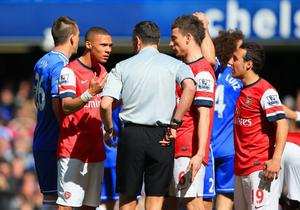 LONDON, ENGLAND - MARCH 22: Kieran Gibbs of Arsenal appeals to Referee Andre Marriner after receiving a red card during the Barclays Premier League match between Chelsea and Arsenal at Stamford Bridge on March 22, 2014 in London, England.  (Photo by Richard Heathcote/Getty Images)