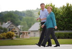 Prime Minister David Cameron welcomes German Chancellor Angela Merkel, to this year's G8 Summit on Lough Erne near Enniskillen in Northern Ireland. PRESS ASSOCIATION Photo. Picture date: Monday June 17, 2013. See PA story POLITICS G8. Photo credit should read: Stefan Rousseau/PA Wire