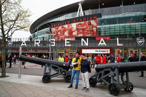 LONDON, ENGLAND - APRIL 21:  Fans pose for photographs outside the stadium prior to the Barclays Premier League match between Arsenal and West Bromwich Albion at the Emirates Stadium on April 21, 2016 in London, England.  (Photo by Paul Gilham/Getty Images)