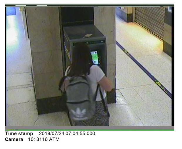 Jenny McDonagh withdrawing cash from an ATM at Charing Cross station (CCTV/CPS/PA)