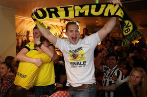 LONDON, ENGLAND - MAY 25:  Borussia Dortmund fans in the Bavarian Beerhouse bar celebrate as their team scores from a penalty in their Champions League final against Bayern Munich on May 25, 2013 in London, England. Bayern Munich and Borussia Dortmund are playing the Champions League final at Wembley Stadium.  (Photo by Peter Macdiarmid/Getty Images)