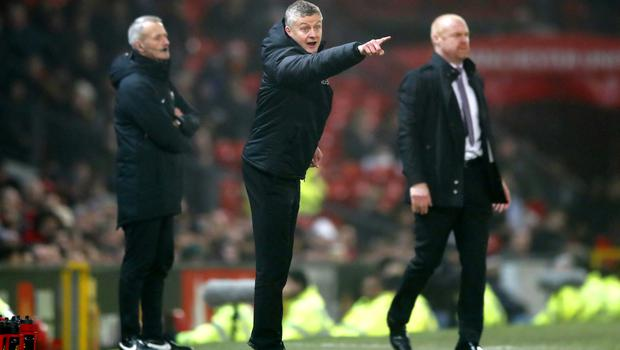 Ole Gunnar Solskjaer (centre) gestures on the touchline during the defeat to Burnley (Martin Rickett/PA),