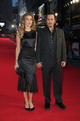 Amber Heard and Johnny Depp in 2015 (Jonathan Brady/PA)