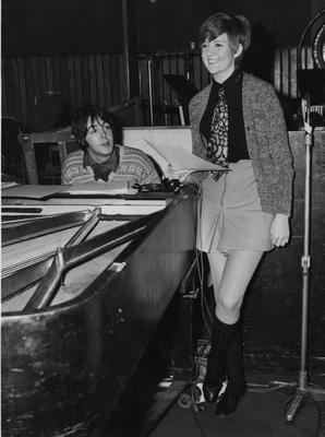 Cilla Black (Priscilla White) rehearses a song with Paul McCartney in a recording studio. (Photo by Express Newspapers/Getty Images)