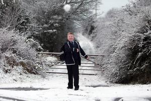 Ben Hicks throws a snowball on his way home from school in the snow, Co Fermanagh - 14th January 2016