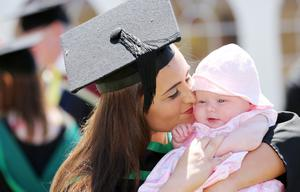 Jayne Fitzsimmons from Lurgan pictured with her 4 month old Daughter Sophia during her graduation in Leisure & Eevnt maagement at the University of Ulster's Summer Graduation at Coleraine. Photo: John Murphy, Aurora PA