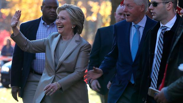 Democratic presidential nominee former Secretary of State Hillary Clinton (L) and her husband former U.S. President Bill Clinton greet supporters after voting at Douglas Grafflin Elementary School on November 8, 2016 in Chappaqua, New York. Hillary Clinton cast her ballot in the presidential election as the rest of America goes to the polls to decide between her and Republican presidential candidate Donald Trump.  (Photo by Justin Sullivan/Getty Images)