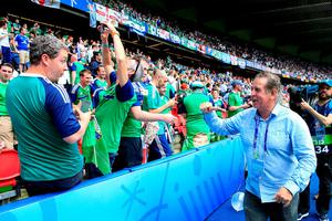 Northern Ireland legend Gerry Armstrong greets the fans beside the pitch before the UEFA Euro 2016, Group C match at the Parc Des Princes, Paris. PRESS ASSOCIATION Photo. Picture date: Tuesday June 21, 2016. See PA story SOCCER N Ireland. Photo credit should read: Jonathan Brady/PA Wire. RESTRICTIONS: Use subject to restrictions. Editorial use only. Book and magazine sales permitted providing not solely devoted to any one team/player/match. No commercial use. Call +44 (0)1158 447447 for further information.