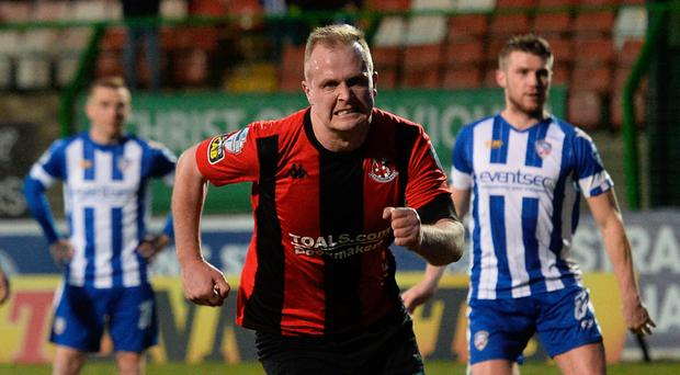 Get in: Crusaders ace Jordan Owens celebrates after netting a penalty in the Irish Cup semi-final
