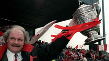 Prize guy: Former Portadown boss Ronnie McFall lifts the 1996 league title