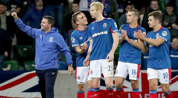 Rousing applause: David Healy leads his Linfield players in celebrating their win against Sutjeska in the previous round