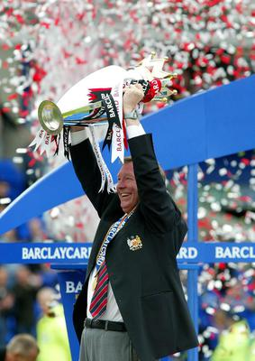 File photo dated 11/05/2003 of Manchester United manager Sir Alex Ferguson holds the Premiership trophy after his side 2-1 win over Everton. PRESS ASSOCITAION Photo. Issue date: Wednesday May 8, 2013. Sir Alex Ferguson will retire at the end of this season, Manchester United have announced. See PA Story SOCCER Man Utd. Photo credit should read: Martin Rickett/PA Wire.