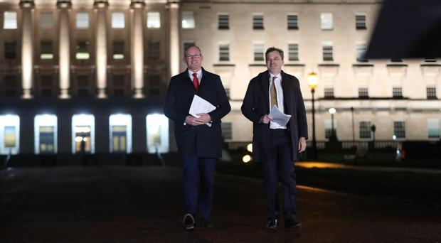 Irish Foreign Affairs minister Simon Coveney (left) and Secretary of State for Northern Ireland Julian Smith (Niall Carson/PA)