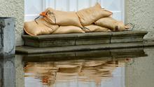 Sandbags at a doorway ahead of the expected high tide after the River Shimna in Newcastle, County Down, burst its banks after Storm Francis hit Northern Ireland causing serious flooding in the Bryansford area of the town