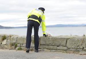 Flowers left  at the Scene at the Pier in Buncrana Co Donegal. Picture Colm Lenaghan/  Pacemaker
