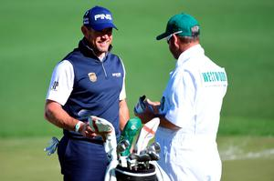 AUGUSTA, GEORGIA - APRIL 07:  Lee Westwood of England and his caddie Billy Foster react after putting for par on the second green during the first round of the 2016 Masters Tournament at Augusta National Golf Club on April 7, 2016 in Augusta, Georgia.  (Photo by Harry How/Getty Images)