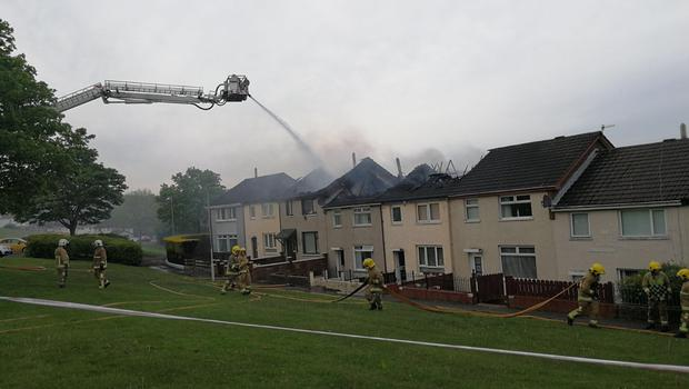 Firefighters tackle the blaze at Ballyduff Gardens. Pic: Paul Hamill