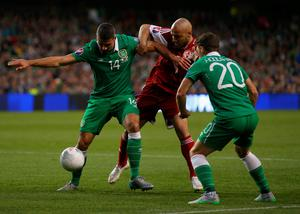 DUBLIN, IRELAND - SEPTEMBER 07:  (L-R) Jonathan Walters of the Republic of Ireland, Jaba Kankava of Georgia and Wes Hoolahan of the Republic of Ireland battle for the ball during the UEFA EURO 2016 Group D qualifying match between Republic of Ireland and Georgia at Aviva Stadium on September 7, 2015 in Dublin, Ireland.  (Photo by Ian Walton/Getty Images)