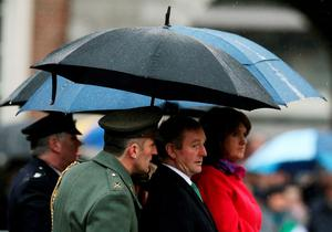 Taoiseach Enda Kenny (second right) with Tanaiste Joan Burton (right) during the first major event to mark the centenary of the 1916 Rising, at Dublin Castle in Ireland. PRESS ASSOCIATION Photo. Picture date: Friday January 1, 2016. Three flags which were flown on O'Connell Street during the rebellion were raised over Dublin Castle in the ceremony attended by President Michael D Higgins, Taoiseach Enda Kenny and Tanaiste Joan Burton. See PA story POLITICS Rising Ireland. Photo credit should read: Brian Lawless/PA Wire