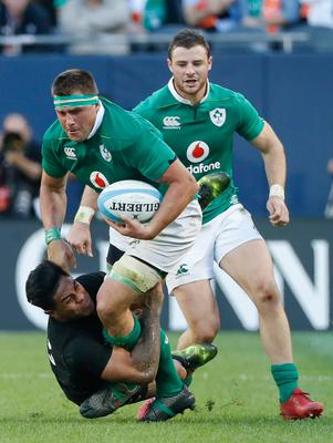 Ireland's CJ Stander, center, is tackled by New Zealand's Malakai Fekitoa, left, during the second half of a rugby match Saturday, Nov. 5, 2016, in Chicago. (AP Photo/Kamil Krzaczynski)