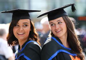 Graduating from Ulster University today with a degree in Fashion and textiles are from left are Amanda Nicholl & Helen Murray. Picture John Murphy Aurora Photographic Agency.