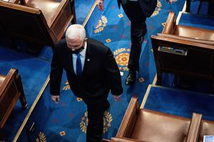 Vice President Mike Pence walks off the House floor as a joint session of the House and Senate convenes to confirm the Electoral College votes cast in November's election, at the Capitol in Washington, Wednesday, Jan. 6, 2021. (Erin Schaff/The New York Times via AP, Pool)