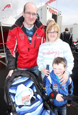 Northern Ireland- 16th May 2013 Mandatory Credit - Photo-Jonathan Porter/Presseye.  The Vauxhall International North West 200 - Second practice day.   Eugene O'Neill with his wife Eliazbeth and two sons Daire(4)  and five-month-old Niall.