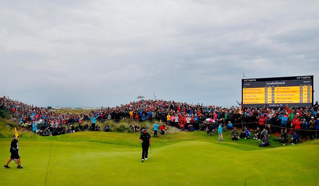 Shane Lowry of Ireland reacts to his birdie putt on the fourth during the final round of The Open Championship at Royal Portrush (Kevin C. Cox/Getty Images)